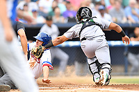 Augusta GreenJackets catcher Jeffry Parra (19) tags out a hard sliding Ryan Vilade (4) during a game against the Asheville Tourists on Crash Davis Night at McCormick Field on June 16, 2018 in Asheville, North Carolina. The GreenJackets defeated the Tourists 7-6. (Tony Farlow/Four Seam Images)