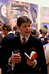 Royal Academy summer annual exhibition, private view party young man with catalogue and glass of Pimms 1980s 1984 UK