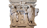 Roman sarcophagus with relief sculptures from Hierapolis . Hierapolis Archaeology Museum, Turkey<br /> <br /> Columned Sarcophagus Sarcopinagu of Euthios Pyrrnon, Asian Archon (ruler), Roman Period First quarter of third century A.D. Loadicea. <br />  <br /> Four sides of these sarcophagi are all in relief. They appear like a columned temple. The reliefs between the grooved columns are related to the private life of the individual. His/her education, heroic scenes and plant or mythological motifs are decorated in relief. The cover of the sarcophagus is arranged like a bed and it is depicted as the wife and the husband as lying on it. The name of the individual and some mythological reliefs are found in the surrounding of the cover. The two sarcophagi in the hall are of this kind. . Against an white background