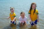 Enjoying the water in Fenit on Sunday, l to r: Kallie Heffernan, Daisy Riordan Breen and Brogan Heffernan.