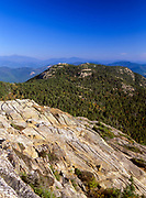 Scenic view of Three Sisters from Mount Chocorua in the New Hampshire White Mountains. The Presidential Range is off in the distance