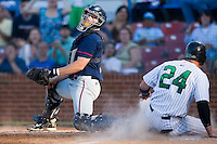 Catcher Brian Juhl (6) of the Kinston Indians tries to make the tag on Billy Killian (24) of the Winston-Salem Warthogs as Killian scores the winning run in the bottom of the 7th inning at Ernie Shore Field in Winston-Salem, NC, Saturday, May 17, 2008.