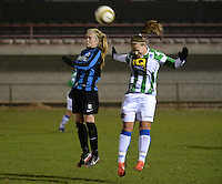 20131213 - VARSENARE , BELGIUM : Brugge's Silke Demeyere (left) pictured with Zwolle's Tessa Klein Braskamp during the female soccer match between Club Brugge Vrouwen and PEC Zwolle Ladies , of  matchday 14  in the BENELEAGUE competition. Friday 13th December 2013. PHOTO DAVID CATRY