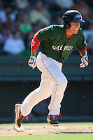 Center fielder Bryan Hudson (18) of the Greenville Drive runs toward first base in a game against the Charleston RiverDogs on Sunday, June 28, 2015, at Fluor Field at the West End in Greenville, South Carolina. Charleston won, 12-9. (Tom Priddy/Four Seam Images)