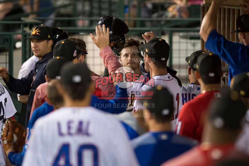 Mesa Solar Sox right fielder Skye Bolt (10), of the Oakland Athletics organization, celebrates with his teammates in the dugout after hitting a home run during an Arizona Fall League game against the Scottsdale Scorpions at Sloan Park on October 10, 2018 in Mesa, Arizona. Scottsdale defeated Mesa 10-3. (Zachary Lucy/Four Seam Images)