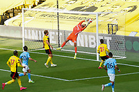 Goalkeeper Ben Foster of Watford saves during the Premier League match between Watford and Manchester City at Vicarage Road, Watford, England on 21 July 2020. Football Stadiums around remain empty due to the Covid-19 Pandemic as Government social distancing laws prohibit supporters inside venues resulting in all fixtures being played behind closed doors until further notice.<br /> Photo by Andy Rowland.