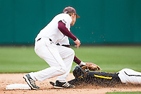 Eric Cheray #14 of the Missouri State Bears tags out a Wichita State Shockers baserunner during a game against the Wichita State Shockers at Hammons Field on May 4, 2013 in Springfield, Missouri. (David Welker/Four Seam Images)