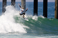American Tanner Gudauskas tailslides during round of 96 at the 2010 US Open of Surfing in Huntington Beach, California on August 4, 2010.