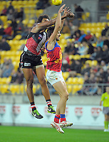 James Gwilt and Sam Mayes compete for the ball during the ANZAC Day AFL match between St Kilda Saints and Brisbane Lions at Westpac Stadium, Wellington, New Zealand on Friday, 25 April 2014. Photo: Dave Lintott / lintottphoto.co.nz