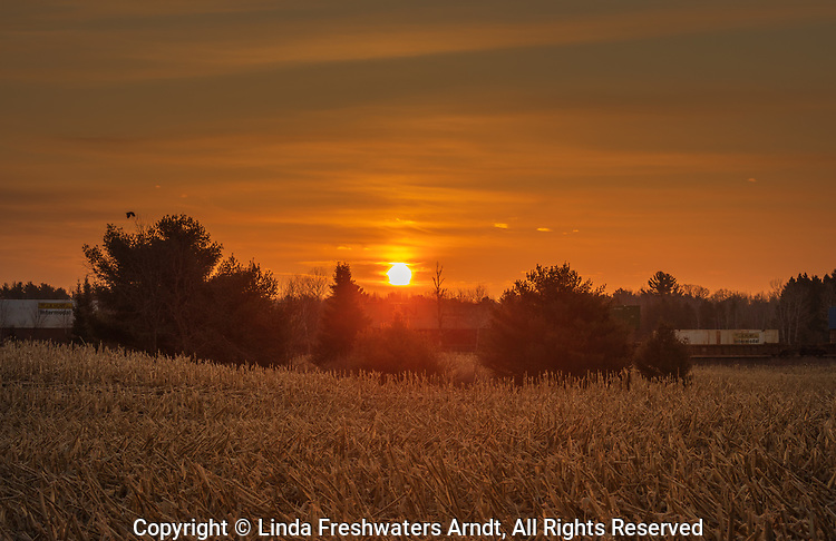 An early morning freight train passing through a farming community in northern Wisconsin.