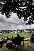 Fans watch from the embankment during day three of the second International Test Cricket match between the New Zealand Black Caps and West Indies at the Basin Reserve in Wellington, New Zealand on Sunday, 13 December 2020. Photo: Dave Lintott / lintottphoto.co.nz