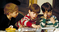 3 young brothers coloring easter eggs. Douglaston NY.
