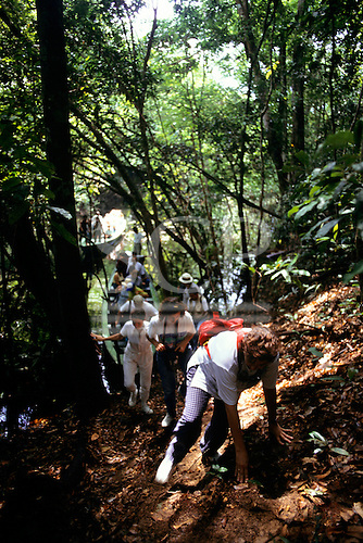 Amazonas State, Brazil. Group of tourists on guided tour in the Amazon rainforest; Anavilhanas Archipelago.