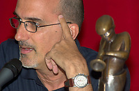 Montreal, June 28th 2001<br /> <br /> American Jazz musician Michael Brecker listen to a question during a press conference before receiving the 8th Miles-Davis Award (seen on the right) from the Montreal Jazz Festibal, June 28th 2001.<br /> <br /> This award highlight the entire work of a Jazz artist  and his contribution to the renewal of the form.<br /> Breckeralready  won 2 grammys awards in 1997 and has played with many musicians including Paul Simon, Herbie Hancock, Pat Metheny and Bruce Springsteen as well as his brother Randy with whom he founded the Brecker Brother in the70's<br /> <br /> <br /> <br /> <br /> <br /> PHOTO :  Agence Quebec Presse