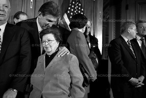 Photographer: Lucian Perkins/Facing Change: Documenting America.Washington,  DC.April 8, 2010.Caption: Senator Joe Manchin, D-W.Va, kisses Sen Barbara Mikulski, D-Md, on the head before the Senate Democratic Caucus update on the budget negotiations