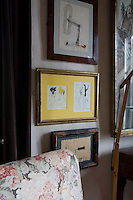 A detail of some of the owner's extensive artwork collection.