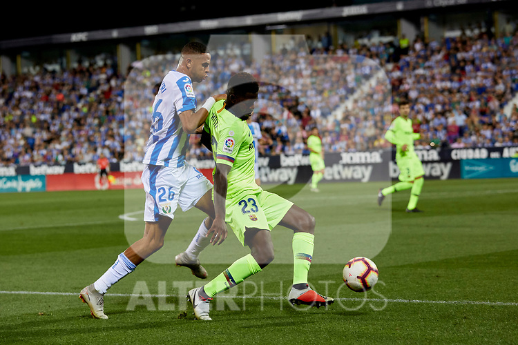 CD Leganes's Youssef En-Nesyri and FC Barcelona's Samuel Umtiti during La Liga match between CD Leganes and FC Barcelona at Butarque Stadium in Madrid, Spain. September 26, 2018. (ALTERPHOTOS/A. Perez Meca)