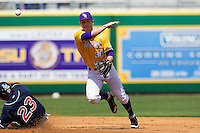 LSU Tigers shortstop Alex Bregman #30 turns a double play against the Auburn Tigers in the NCAA baseball game on March 24, 2013 at Alex Box Stadium in Baton Rouge, Louisiana. LSU defeated Auburn 5-1. (Andrew Woolley/Four Seam Images).