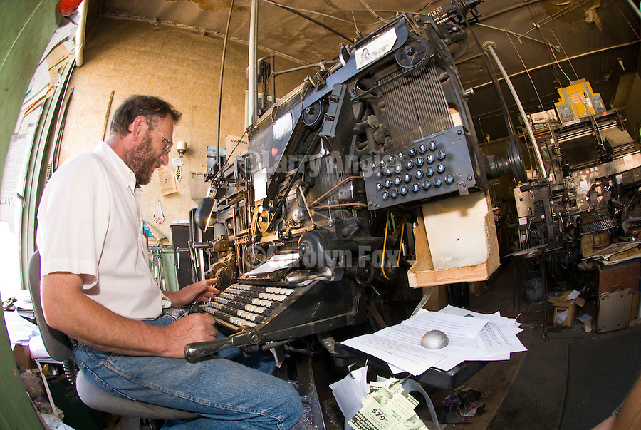 Dean Coombs, third generation newspaperman, publisher and printer at the Saguache Crescent Newspaper, last of the hot metal newspapers in the U.S. sets type at the keyboard of his 1921 Linotype machine.