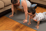 3 year old boy at home exercising doing push ups with mother