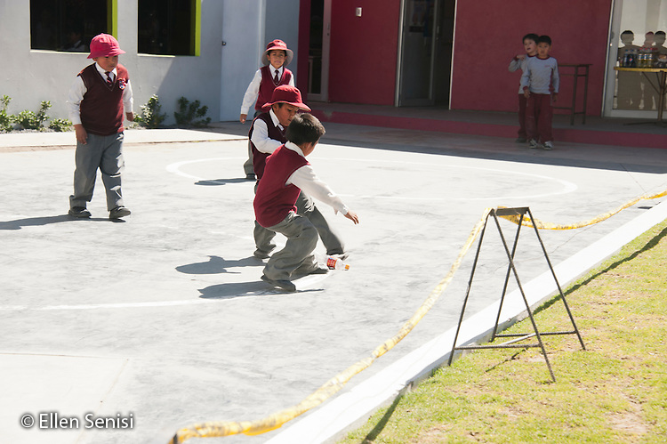Arequipa, Peru. Hefziba, a parochial (Christian), private school for elementary and secondary school students. Students (boys, Peruvian, elementary-school aged) play soccer with soda bottle outside at recess time. No MR. ID: AL-peru.