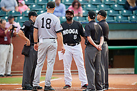 Chattanooga Lookouts manager Tommy Watkins (8) meets with Jackson Generals manager Shelley Duncan (18), home plate umpire Ben Sonntag, first base umpire Anthony Perez and third base umpire Jonathan Parra before a game against the Jackson Generals on May 9, 2018 at AT&T Field in Chattanooga, Tennessee.  Chattanooga defeated Jackson 4-2.  (Mike Janes/Four Seam Images)
