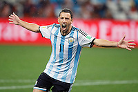 Maxi Rodriguez of Argentina celebrates scoring the final penalty to win the match