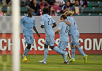 CARSON, CA - April 1, 2012: CJ Sapong (17) and teammates celebrate a goal during the Chivas USA vs Sporting KC match at the Home Depot Center in Carson, California. Final score Sporting KC 1, Chivas USA 0.