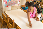 Education Preschool 3-4 year olds classroom scenes girl cleaning table before meal