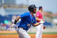 Biloxi Shuckers first baseman Nick Ramirez (14) runs to first during the first game of a double header against the Pensacola Blue Wahoos on April 26, 2015 at Pensacola Bayfront Stadium in Pensacola, Florida.  Biloxi defeated Pensacola 2-1.  (Mike Janes/Four Seam Images)