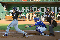 Joe Munoz (37) of the Missoula Osprey follows through on his swing against the Ogden Raptors with Raptors Kyle Farmer (18) and home plate umpire Alex Mackay behind the plate at Lindquist Field on July 17, 2013 in Ogden Utah. (Stephen Smith/Four Seam Images)