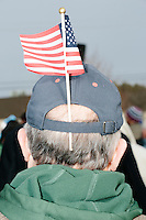 Cruz supporter Bruce Beane stands with an American flag in his cap before Texas senator and Republican presidential candidate Ted Cruz speaks at a Second Amendment Rally outside Granite State Indoor Range in Hudson, New Hampshire.