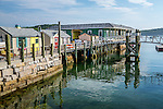 Shops on the Harborside boardwalk in Bar Harbor, Maine, USA, WIM