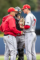 Rutgers Scarlet Knights head coach Joe Litterio talks on the mound with his catcher Tyler McNamara (28) and pitcher Tommy Genuario (27) during the NCAA baseball game against the Michigan Wolverines on April 27, 2019 at Ray Fisher Stadium in Ann Arbor, Michigan. Michigan defeated Rutgers 10-1. (Andrew Woolley/Four Seam Images)