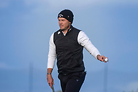 3rd October 2021; The Old Course, St Andrews Links, Fife, Scotland; European Tour, Alfred Dunhill Links Championship, Fourth round; Danny Willett of England acknowledges the applause of the crowd after holing a par putt on the 17th green during the final round of the Alfred Dunhill Links Championship on the Old Course, St Andrews