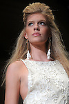 A model walks the runway during the Douglas Hannant show at the first night of Fashion Houston at the Wortham Theater Monday Oct. 10,2011.(Dave Rossman/For the Chronicle)