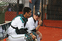 Pitcher Cody Wheeler #5  (on the right) and  Catcher Jose Iglesias #35 (on the left) of the Coastal Carolina University Chanticleers talking in the bullpen before a game against  the University of San Diego Toreros  at Watson Stadium at Vrooman Field in Conway,, SC on March 26, 2010. Photo by Robert Gurganus/Four Seam Images