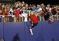 BOCA RATON, FL - DECEMBER 15, 2012: Megan Rapinoe (15) of the USA greets fans at the end of an international friendly match against China at FAU Stadium, in Boca Raton, Florida, on Saturday, December 15, 2012. USA won 4-1.
