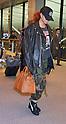 Rihanna Arrives at Airport in Japan