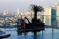 PHILIPPINES, Manila, suburban Makati, high buildings, swimmimgpool of City Garden Grand Hotel Makati / PHILIPPINEN, Manila, Stadtteil Makati, Hochhaeuser