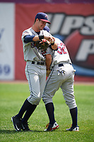 Mahoning Valley Scrappers Ernie Clement (24) and Jesse Berardi (52) joke around after warmups before the first game of a doubleheader against the Auburn Doubledays on July 2, 2017 at Falcon Park in Auburn, New York.  Mahoning Valley defeated Auburn 3-0.  (Mike Janes/Four Seam Images)