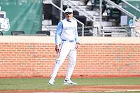 CHAPEL HILL, NC - FEBRUARY 27: Head coach Scott Forbes #21 of North Carolina works as third base coach during a game between Virginia and North Carolina at Boshamer Stadium on February 27, 2021 in Chapel Hill, North Carolina.