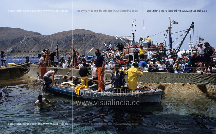 ITALY, Sicily, Egedian island Favignana, La Mattanza, traditional fishing of bluefin Tuna fish, rais (chief) Gioacchino Cataldo and tourists watching the spectacle