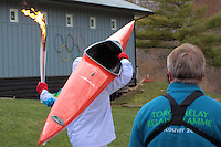 Multi Olympic medalist, Canadian Adam Joseph van Koeverden carries the Olympic torch and his Kayak past the Burloak Canoe Club in Oakville, Ontario, Canada on December 19th.