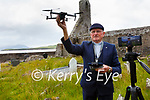 Fr Patsy Lynch from the Parish of Prior(Portmagee, The Glen & Ballinskelligs) reaches out to all those unable to attend funerals and services with Live Streaming and and edited Drone footage.  Pictured here at the Abby Cemetery in Ballinskelligs.