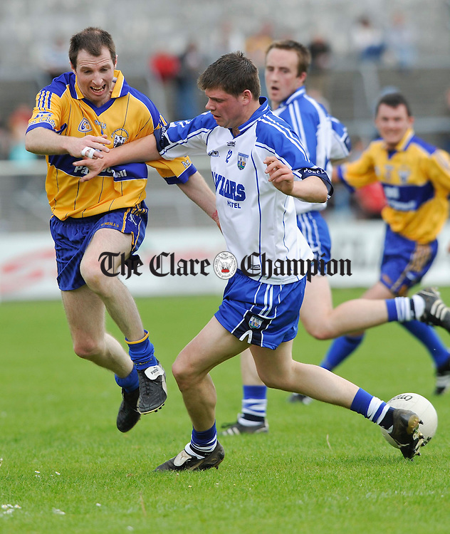 Niall Considine of Clare dispossesses Waterford's Patrick Hurney during their senior championship game in Cusack Park. Photograph by John Kelly.
