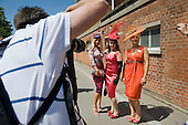Women with designer hats pose for photographers before entering the Royal Enclosure at Ascot racecourse on Ladies Day during Royal Ascot week.