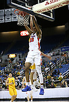 Bishop Gorman's Jamal Bey dunks against a Bishop Manogue defender during the 4A NIAA state basketball championship game in Reno, Nev., on Friday, Feb. 23, 2018. Gorman won 62-41. Cathleen Allison/Las Vegas Review-Journal