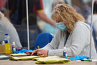 Pictured: A lady counts ballot papers during The Swansea East and Gower Election Count at LC in Swansea, Wales, UK. Friday 07 May 2020