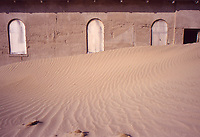 Desert miners town abandoned in 1954. Sand inside the rooms /sabbia all'interno delle case